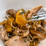 A fork digging into the Slow Cooker Ginger Peach Chicken