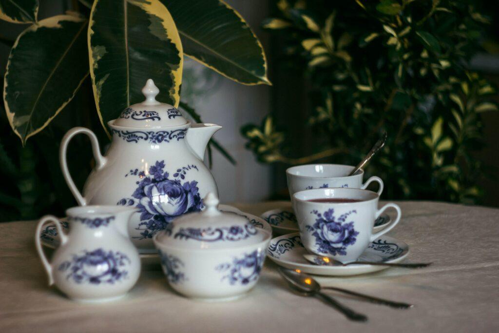 A white and blue tea set