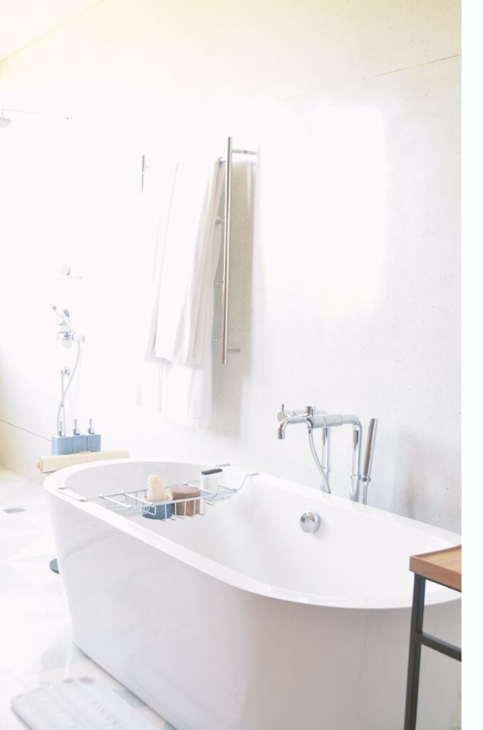 A bright, white room with a bath tub and supplies: 28 Rainy Day Activities for Adults
